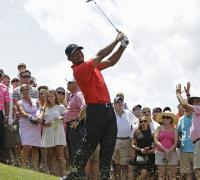 Tiger Woods puts on a brave face as he battles his demons at Sawgrass
