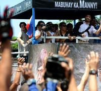 Crowds welcome defiant Manny Pacquiao on return to Philippines